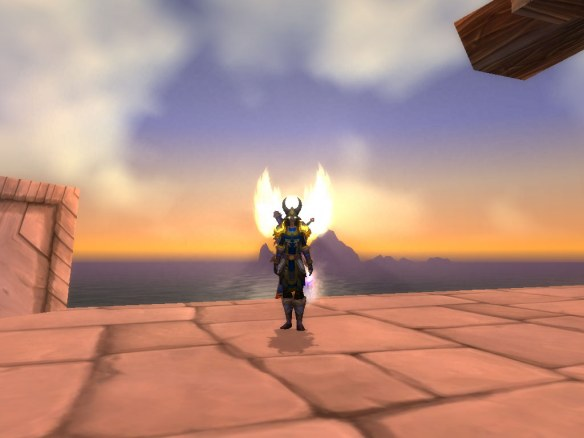 My paladin silhouetted by the sun in Stormwind Harbour