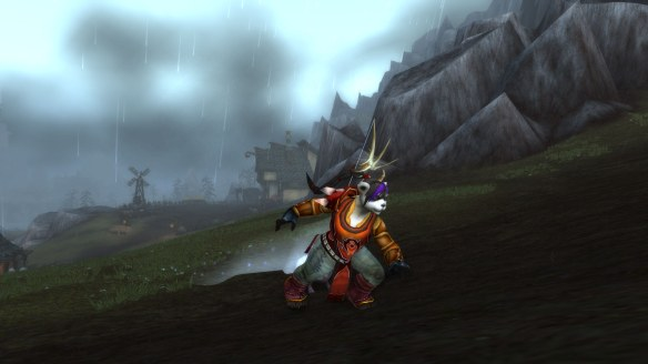 My Pandaren hunter running through the Ruins of Gilneas in World of Warcraft
