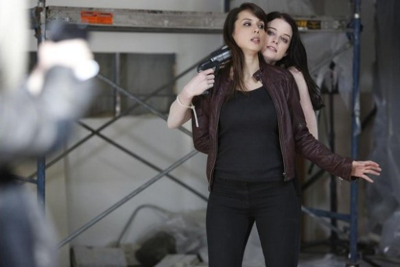 "Kiera holds Sonya hostage in ""3 Minutes to Midnight"" from Continuum's third season"