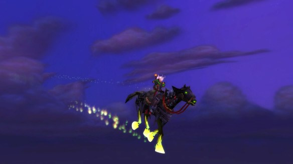 My warlock riding my Headless Horseman's steed in World of Warcraft