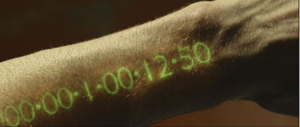 A forearm display of a person's dwindling time from the movie In Time