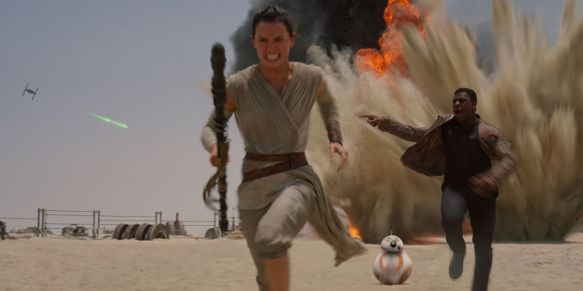Rey (Daisy Ridley) and Finn (John Boyega) flee danger in Star Wars: The Force Awakens