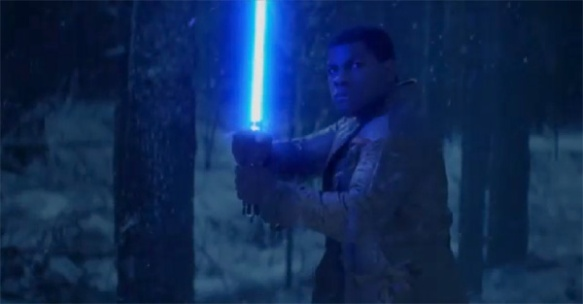 Finn (John Boyega) wields a lightsaber in Star Wars: The Force Awakens
