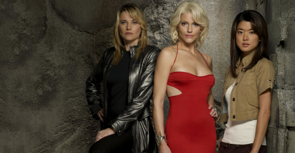 Lucy Lawless, Tricia Helfer, and Grace Park as the Cylons Three, Six, and Eight in Battlestar Galatica