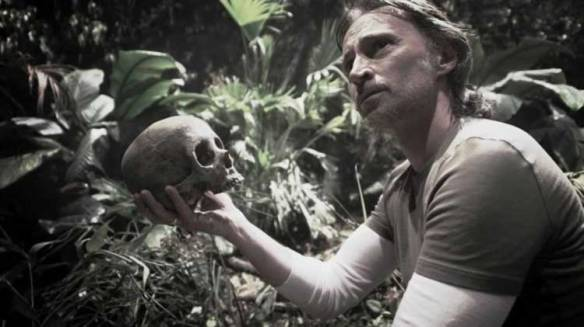 Dr. Rush examines his own skull in Stargate: Universe